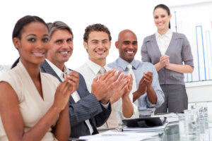 business minded people clapping their hands